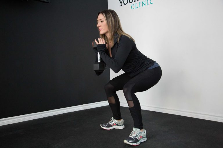squat with a dumbbell